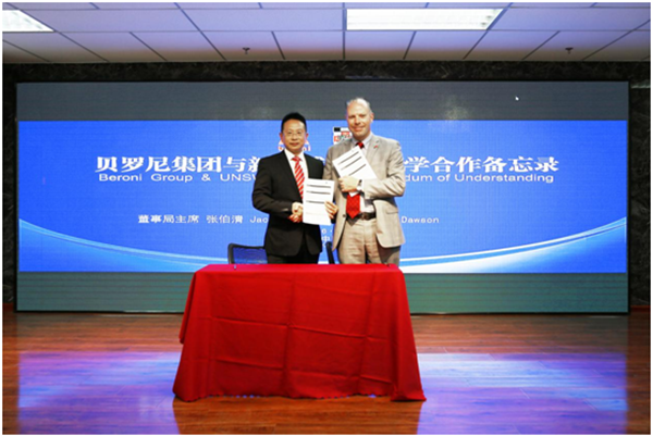 Mr. Zhang and Mr. Dawson displaying the signed MOU