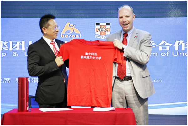 Mr. Dawson gave a bottle of wine and UNSW t-shirt to Mr. Zhang