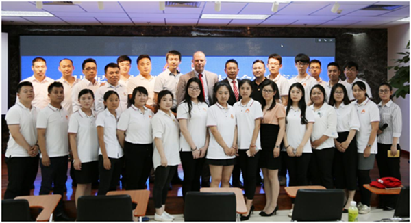 Mr.Zhang and Mr. Dawson taking a group photo with the Beroni team