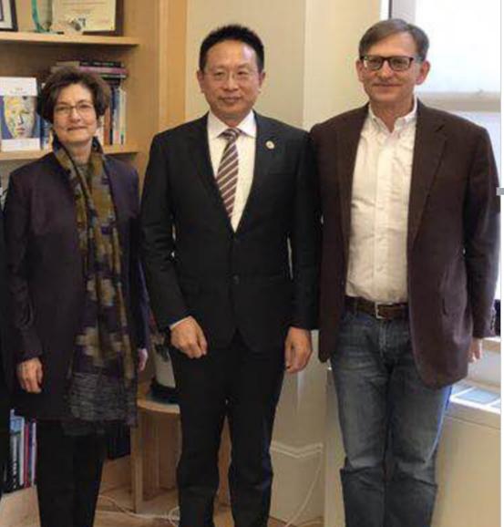 A picture of Mr. Zhang Boqing, Professor Linda P. Fried and Professor Walter Ian Lipkin
